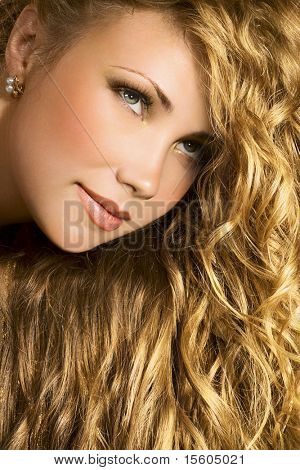 Gorgeous woman with long golden hair
