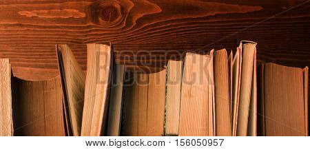 old books on wood, view from above