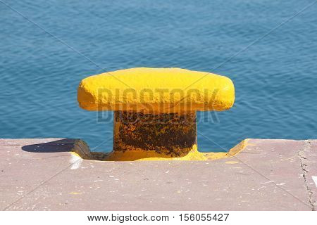 Detailed view of an iron dock cleat in a harbour