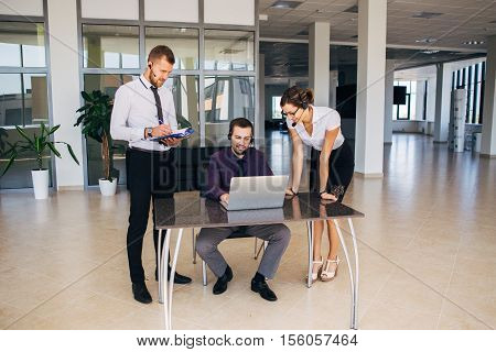 Sales assistants working with computers in an modern office