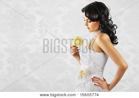 Beautiful bride in wedding dress on refined white background. Space for text.