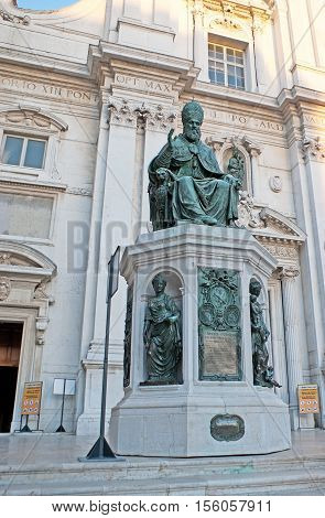 LORETO ITALY - OCTOBER 6 2012: The bronze statue of the Pope Sixtus V at the entrance to Sanctuary of Santa Casa on October 6 in Loreto.