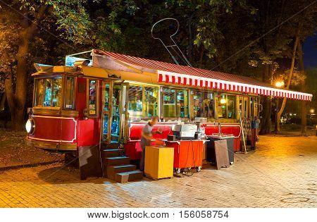 KIEV UKRAINE - SEPTEMBER 11 2016: The interesting outddor cafe in old tram in Taras Shevchenko park offers tea coffee and refreshing beverages on September 11 in Kiev.
