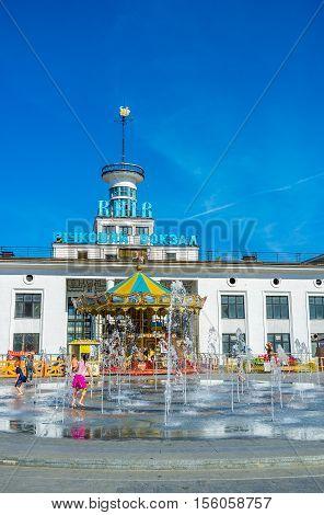 KIEV UKRAINE - SEPTEMBER 8 2016: The fountain in Postal (Poshtova) Square with the River Port on the background on September 8 in Kiev.