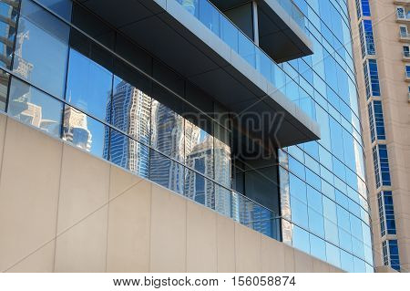 part of a multi-storey office building glass.