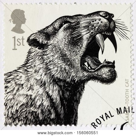 LUGA RUSSIA - NOVEMBER 6 2016: A stamp printed by GREAT BRITAIN shows Saber-Toothed Cat - Ice Age Animal circa 2006