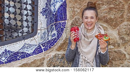 Smiling Tourist Woman At Guell Park In Barcelona At Christmas