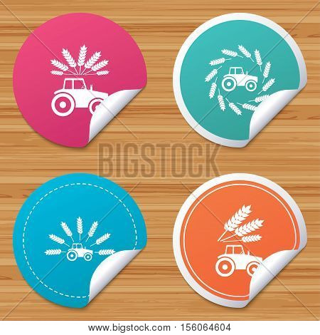 Round stickers or website banners. Tractor icons. Wreath of Wheat corn signs. Agricultural industry transport symbols. Circle badges with bended corner. Vector