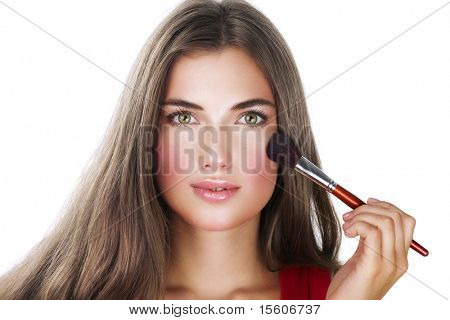 Beauty with perfect natural makeup look applying blusher