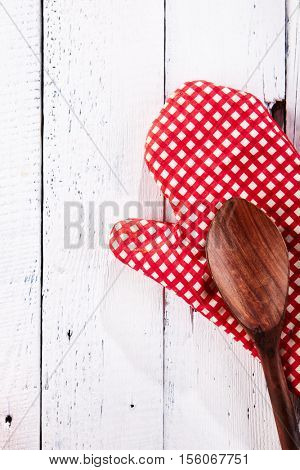 Pumpkin and Kitchen Mitts on Wooden Background Top View