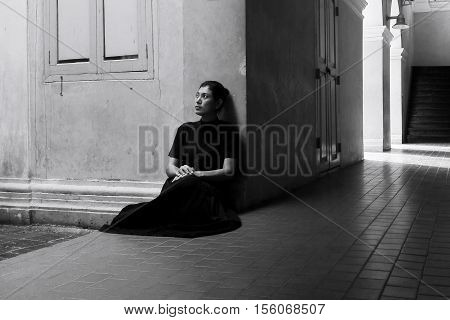 Dark Portrait Of Sad Asian Woman In Black Clothes At The Old Building.
