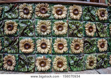 Comillas Spain - August 24 2016: La Villa Quijano popularly known as El Capricho is a modernist building in Comillas. Designed by Antoni Gaudi Detail ceramic floral motif with sunflowers