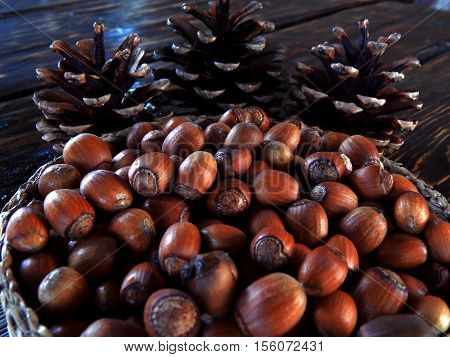 Autumn. Autumn gifts. Autumn harvest. Nuts. . Nuts in a basket. Nuts on the table. Cones