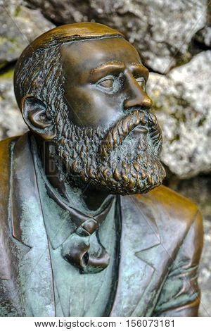 Comillas Spain - August 24 2016: Bronze statue of Antonio Gaudi In La Villa Quijano popularly Known as El Capricho Comillas Cantabria Spain