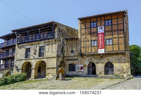 Santillana Del Mar Spain - August 23 2016: The Houses of Aguila and Parra are in the Plaza Mayor in the historic center of Santillana del Mar next to City Hall. Cantabria