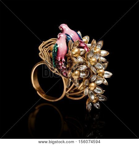 Close up of beautiful Birds on Diamond Ring with golden Egg , with many different precious Gemstone over black background