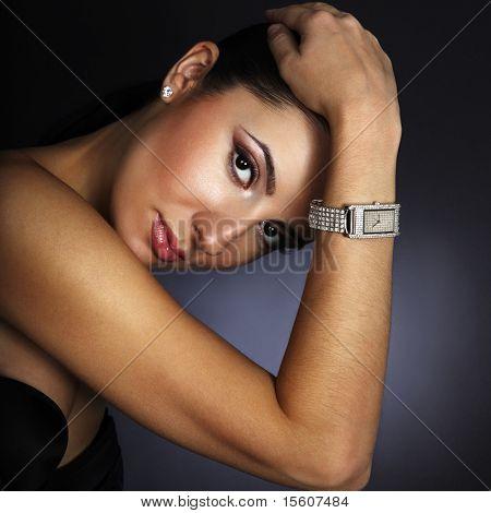 Beautiful woman with silver wristwatch
