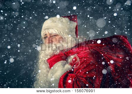 Santa Claus Carries Gifts.