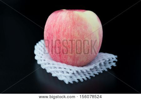 fresh apple on a protective foam on black background
