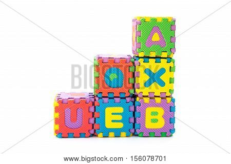 blocks made by alphabet jigsaw puzzle on white