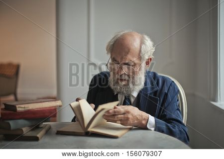Historian studying a book