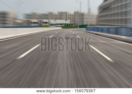 a fast moving blacktop horizontal composition in day time