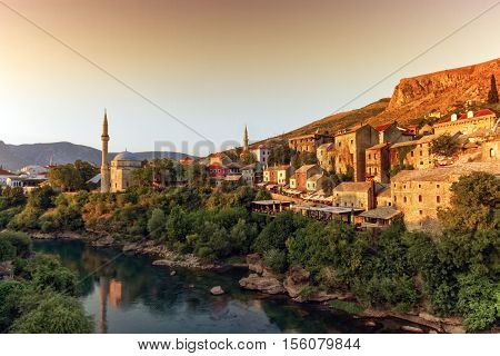 View of Neretva river and old city of Mostar old city by sunset, Bosnia and Herzegovina