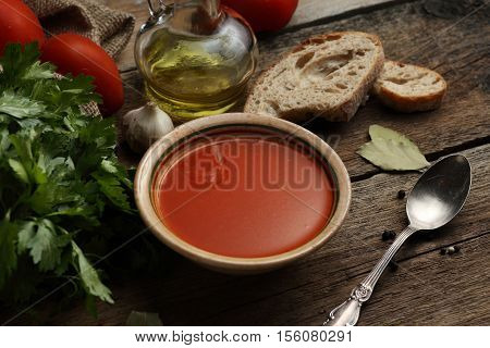 Tomato Cream Soup With Ingredients On Wooden Background.