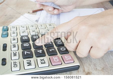 finger to press calculator document monthly expenses credit card accounting