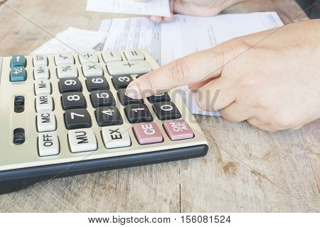 finger to press calculator checking document monthly expenses credit card accounting
