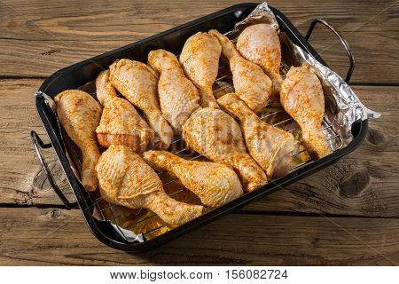 a roasting pan full of chicken thighs