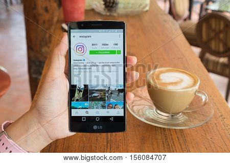 CHIANG MAI THAILAND - AUG 232016: A woman holds LG G4 with new logo of Instagram application on the screen. Instagram is a photo-sharing app for smartphones.