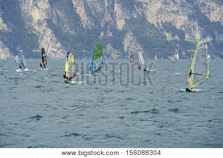 Torbole - Nago, Lago di Garda (Lago Benaco), Italy - August 11, 2015: A windsurfing on Lake Garda in Torbole resort.