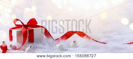 Christmas card with gift boxes and Christmas decorations on a white background