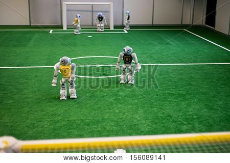 Robots football. Robots programed to play by themself footbal