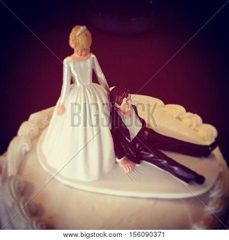 humorous wedding cake topper - bride and unhappy groom