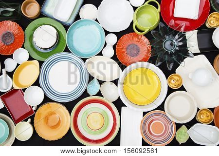 Various colorful dishes on a black background
