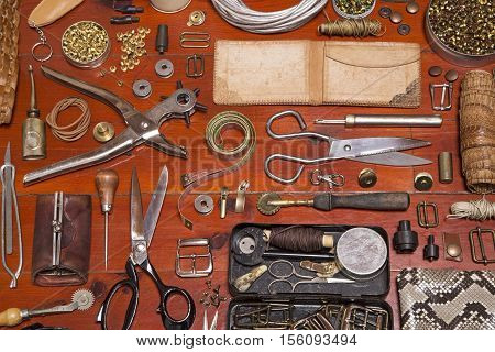 Leather craft tools on a wooden floor