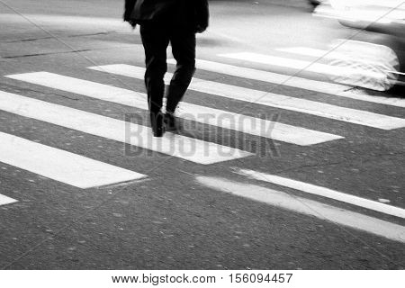 The Man walking on zebra crossing street.