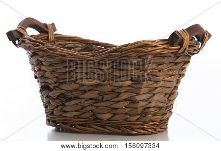crafty wicker basket isolated on white background