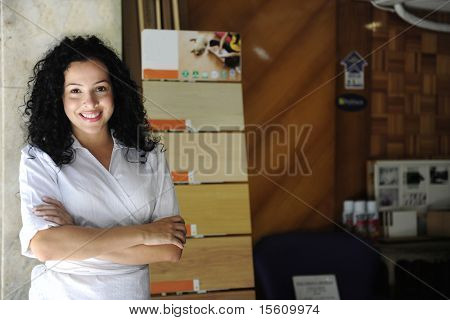 small business: portait of a proud floor store owner