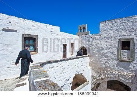 Patmos Greece - May 16 2010: Priests in the Agios Joannis Theologos Monastry