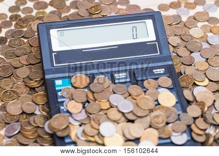 calculator and a stack of coins - Polish currency zloty