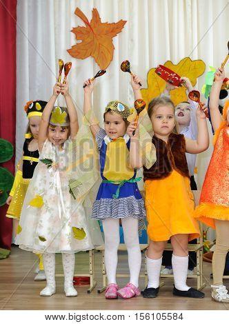 BALASHIKHA RUSSIA - OCTOBER 26: Children dressed in carnival costumes taking part in autumnal matinee in kindergarten on Zarechnaya Street on October 26 2016 in Balashikha.