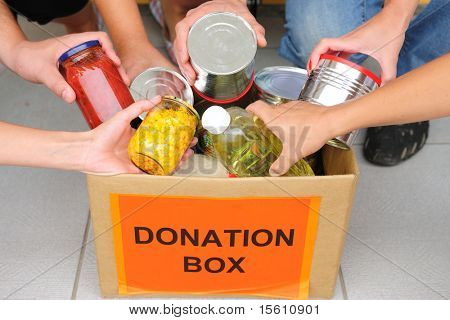volunteer putting food in a donation box
