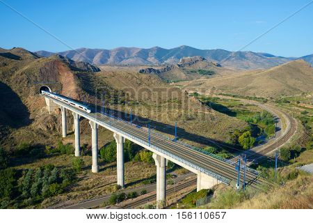view of a high-speed train crossing a viaduct in Purroy, Zaragoza, Aragon, Spain. AVE Madrid Barcelona.