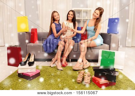 Three Woman Celebrating Successful Shopping And Clinking With Glasses Of Shampagne