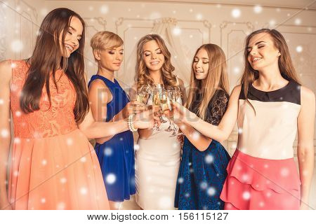 Group Of Women Toasting At A Celebration Of New Year And Clinking Their Glasses