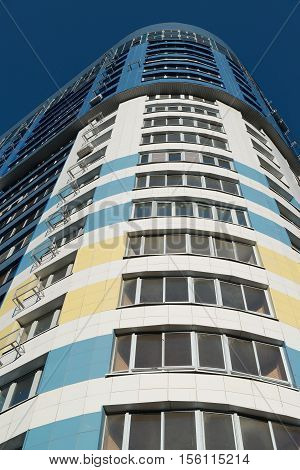 modern multi-storey residential building on a background of blue sky