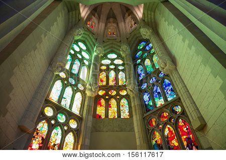 BARCELONA SPAIN - JUNE 10: Sagrada Familia interior view on June 10 2014 in Barcelona Spain. Designed by Antoni Gaudi the church is still incomplete.